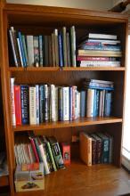 Three shelves of assorted books gardens, cooking, flight, etc