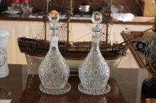 Pair of Baccarat cut crystal decanters and a pair of  Baccarat stands, each approx 35cm H (4)