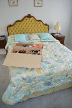 Upholstered head board with a wool filled mattress base with a doona and cushions