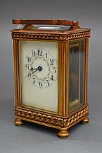 Antique brass case carriage clock with porcelain