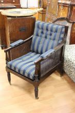 Rare antique Regency mahogany Bergere arm chair circa 1820's. With caned sides, seat and back, fluted arm and turned fluted legs