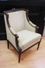 Fine antique French Louis XVI style armchair, of winged design, finely carved in relief, turned fluted front legs