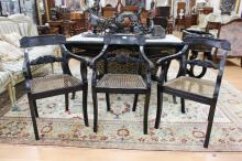 Set of three antique Anglo Indian ebonized armchairs, circa 1835-1840. Sabre front legs, well carved backs with Thomas Hope inspired centre rails (3)