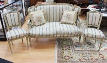 Antique French Louis XV three piece suite, comprising a wing settee and pair of side chairs, painted with gilt & green (3)