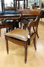 Set of eight antique English early 19th century provincial mahogany dining chairs with carved back bars, spade shaped backs, all standing on turned tapering legs, includes two armchairs (8)