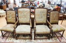 Set of four large antique carved walnut French high back chairs, comprising a pair of arm chairs and two side chairs (4)