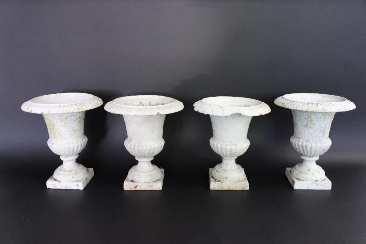 Four antique French small cast iron urns, each approx 24cm H (4)