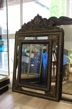 Antique mid 19th century French repousse brass and ebonized slip cushion mirror, approx 138cm H x 87cm W