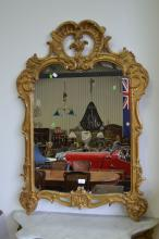 Antique 19th century French Louis XV giltwood mirror, large pierced double C scroll crest, approx 116cm x 80cm