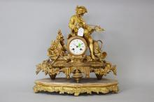 Antique French gilt spelter figural clock, mounted with a violin playing gent, musical trophies and wine related decoration,  no key, has pendulum (in office), approx 47cm H x 45cm W x 16cm D