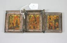 Russian metal & painted wooden travelling iconostas, consisting of three panels set with hinged metal frames,  the central panel depicting the Nativity, flanked by the Presentation in the Temple and a related scene from the Church calendar,  18th century. The cycle is executed in fine detail in s style associated with Moscow in the 16th- 17th centuries, approx 10.5cm H x 25.5cm W total