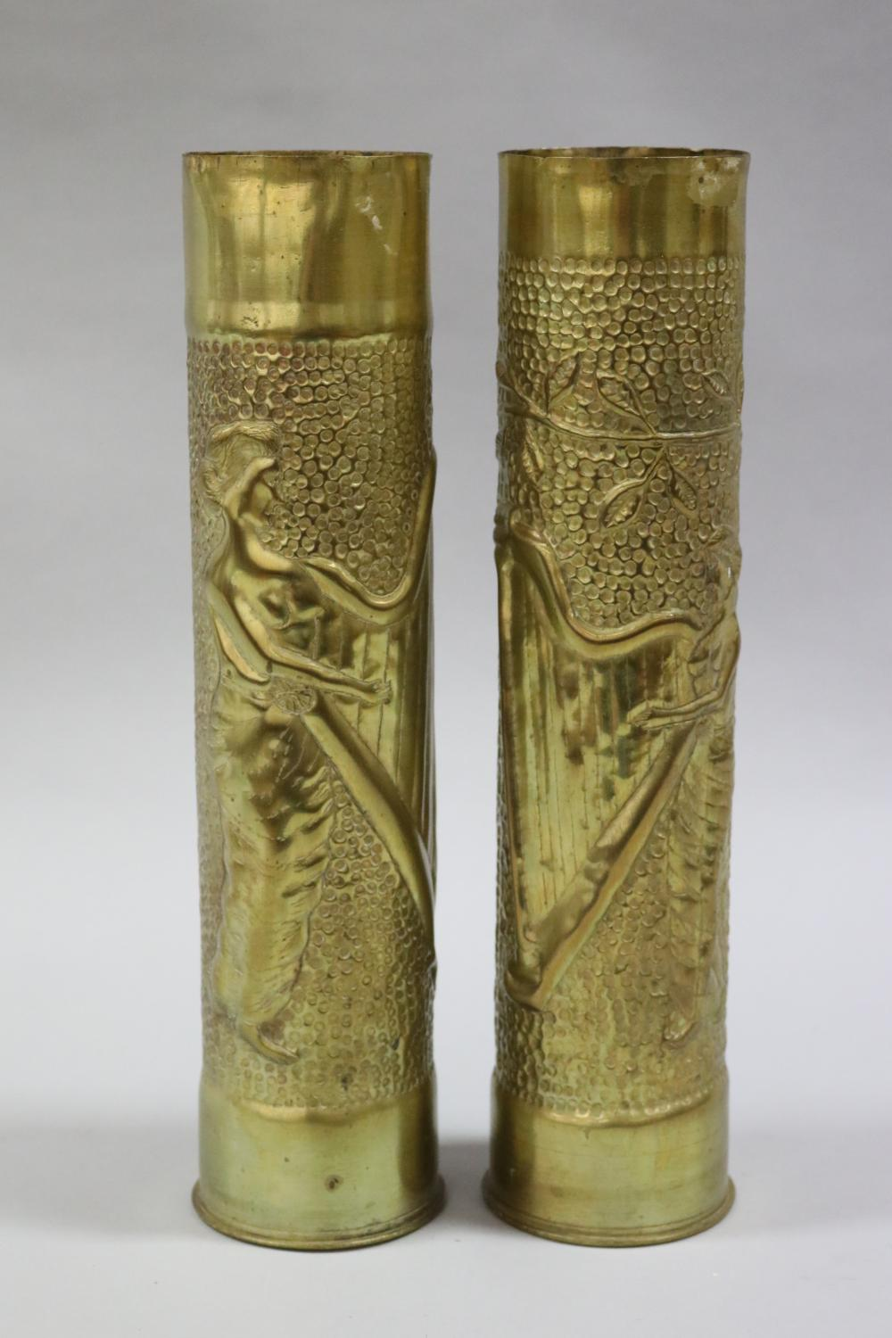 Pair of French WWI brass trench art vases, embossed with lady playing harp to each (2)