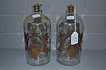 Pair of decanters with gilt decoration, each