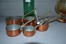 Set of five small French Antique copper saucepans
