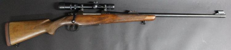Near perfect Brno model 602 bolt action repeating rifle in .375 H & H magnum calibre. Checkered pistol grip stock. Fitted with Nikko Stirling gold crown telescopic sight. Serial no. 16552 L/R NSW