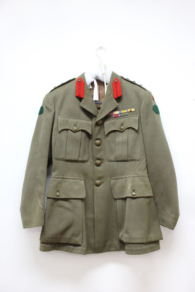 Australian army officers khaki wool uniform consisting of trousers and tunic with GVR buttons, medal ribbons, collar tabs and rank insignia of a Colonel