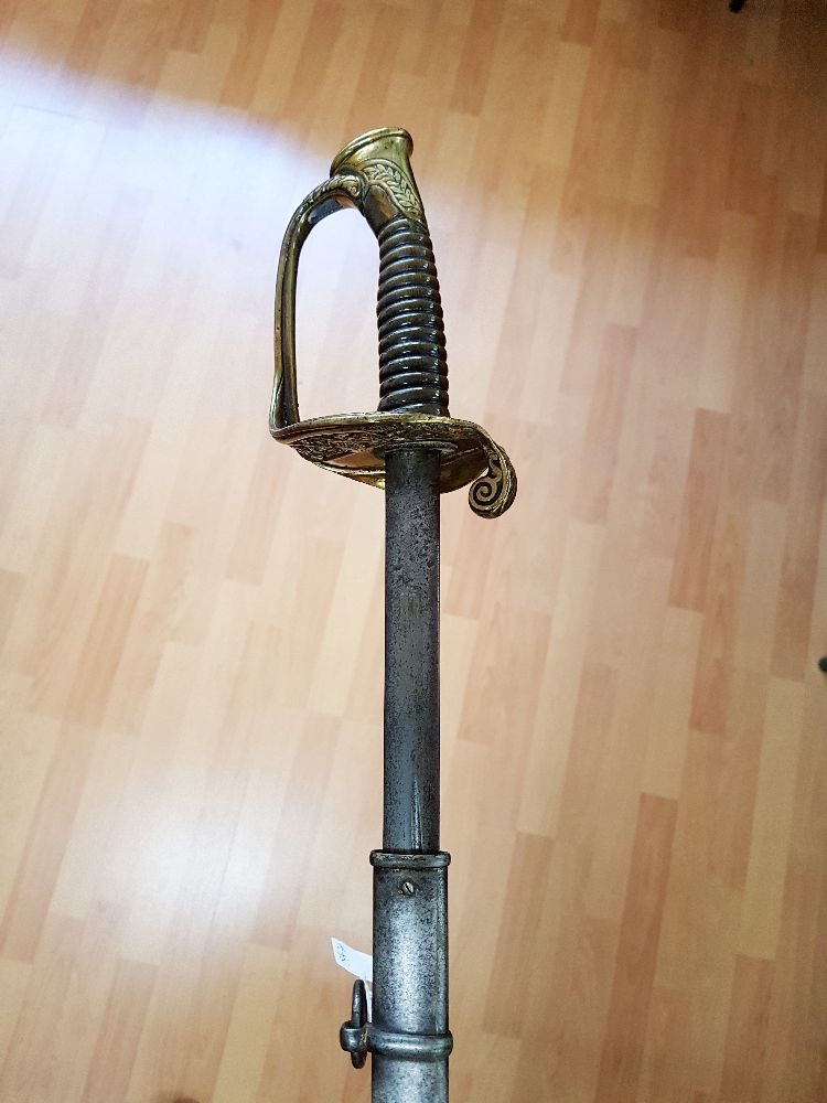 French infantry officer's sword with scabbard. Double edged blade with offset fullers, gilt brass guard, horn grip, approx 100cm L overall.