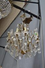 Vintage French eight light crystal chandelier, fitted with large facetted drops