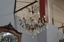 Vintage French eight light chandelier, bronze arms with cut crystal drops