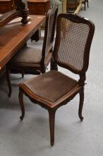 Set of four antique carved walnut Louis XV style chairs, with caned seats (4)