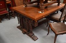 Impressive French Gothic carved oak drawer leaf dining table, well carved column ends with central stretcher, approx 76cm H x 154cm W x 108cm D