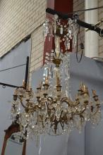 Impressive early 20th century French 18 light chandelier, gilt metal arms draped with chains of beads