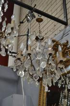 Vintage French eight light chandelier, central spiral glass column, with applied faceted drops