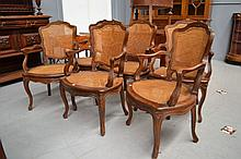 Set of six French carved oak arm chairs with caned