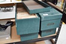 An extensive collection of Art, History & travel postcards in long haberdashery boxes covered in dark green baize with ID holders at end. Originally collar boxes from Peapes Menswear Store,  a heritage building in George Street Sydney.(4)