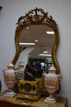 Antique French gilt surround mirror of waisted shape, with pierced foliate crest, approx 134cm H x 89cm W