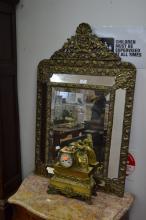 Antique French brass cushion mirror, approx 95cm x 59cm