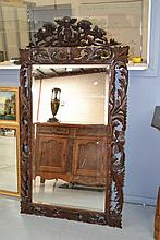 Antique French carved oak cushion mirror with