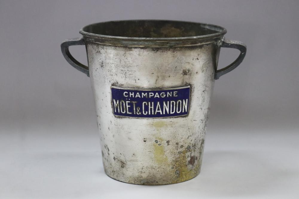 """Old French pewter twin handled champagne bucket, with applied blue enamel plaque """"Champagne Moet & Chandon"""" the handles decorated with grape vine motif, approx 19cm H x 18.5cm dia (excluding handles)"""