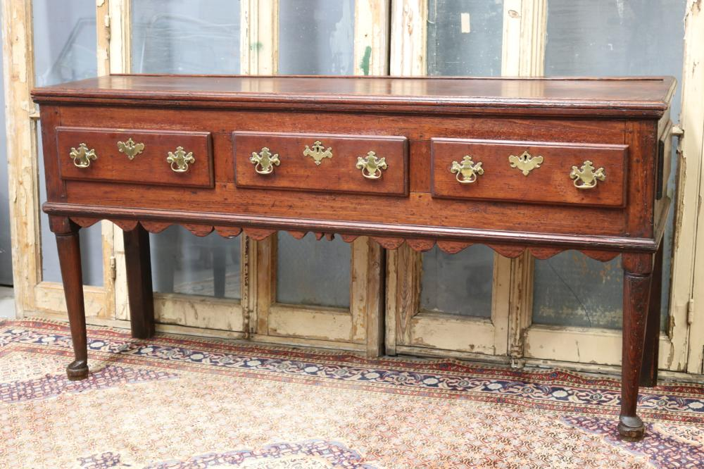 Antique English George III dresser base, three deep drawers, brass hardware, standing on cabriole legs. Likely earlier, approx 91cm H x 182cm W x 50cm D