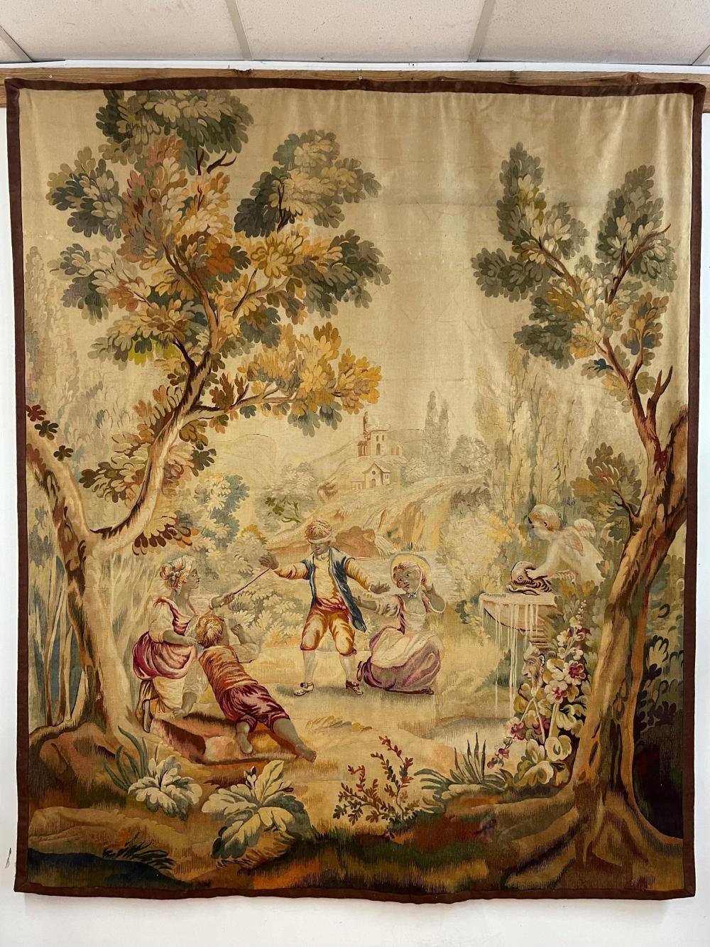Antique French handwoven pastoral landscape tapestry, children playing blind mans buff, relined, approx 220cm x 186cm W