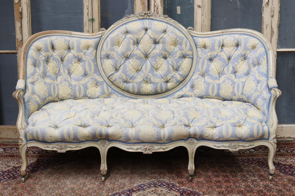 Antique French Louis XV style shaped back settee, painted frame with deep button upholstery, all on castor, approx 108cm H x 177cm W x 81cm D