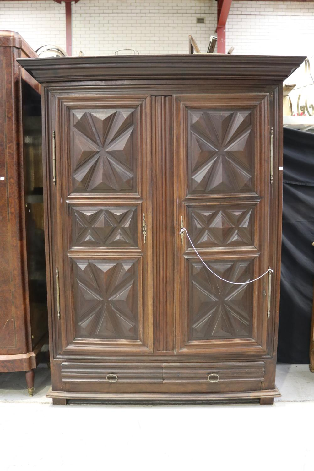 Antique 19th century French armoire, with geometric carved panel doors, two drawers & two doors, approx 215cm H x 166cm W x 70cm D