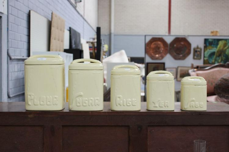 set of five bakewell yellow ceramic kitchen canisters appro