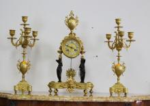 Antique French Empire mantle clock and garnitures, showing black cast figures to the supports of the clock, has key (in office) and pendulum, clock approx 44cm H x 25cm W x 11cm D (3)