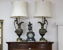 Two cast bronze Renaissance style ewers converted into lamps and decorated by putti, each approx 100cm H including shades (2)