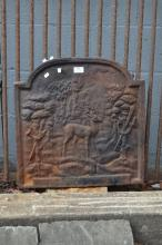 Antique French cast iron fireback, cast in relief with a deer and spears, approx 52cm H x 52cm W