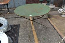 Antique French metal folding garden table, distressed green painted finish, (A/F to leg), approx 74cm H x 90cm dia