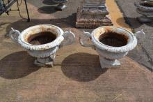 Pair of antique French cast iron twin handled garden urns, approx 34cm H x 45cm dia (2)