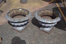 Pair of antique French cast iron garden urns, roll over rims, egg and dart centre decoration in relief, all standing on square bases (2)