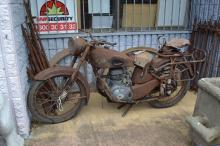 Barn find - Vintage French Motoconfort motorcycle, showing traces of original brown paint, but mostly rustic, original guards & pillion seat.  Approx 170cm L