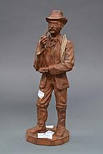 Small French carved wood figure of a man smoking,