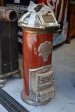 Cyclop cylinder form stove, with iron red cylinder
