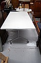 Folding table with white Melamine top on castors