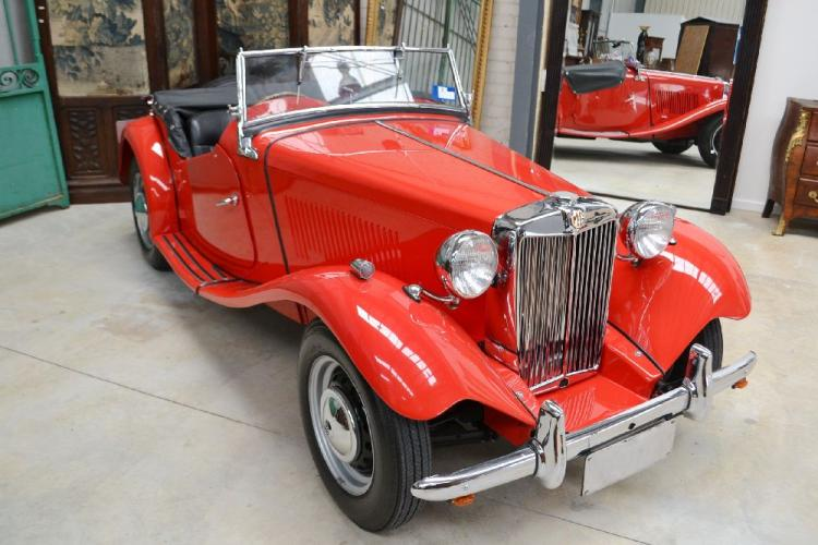 "1951 MG TD Chassis – TD 11753 Engine – XPAG/TD2/12235 When the world thinks of sports cars, it thinks of MG.Formed in 1923 as Morris Garages, MG was initially a sideline business to market re-bodied Morris cars to a slightly more sporting clientele. By the late 1920s a distinct MG was released that was equipped with what was to be seen as the traditional MG vertical grille. This was followed by the smaller MG Midget, a title that stayed with the marque through to the 1980s. While the MG may be associated with open top sports cars, the company was also responsible for many sporting saloons that proved highly popular to those who wanted a sports car, but needed the practicalities of a closed car. Not long prior to World War Two, MG launched the first of its T-Series Midgets. Both the TA and TB proved to be popular, but with the war, MG turned its attention to assisting the British war effort. After the War, MG released its venerable TC, a model that's seen by many as the archetypal MG. Despite this, the TC did have its limitations, including being only available in right hand drive – hardly practical for the all-important US market. With Britain in need of overseas funds the government edict was ""Export of Perish!"" MG's response was the MG TD in both right and left hand drive. Despite being available with steel disc wheels in place of the traditional wires, the TD proved to be highly successful with 30,000 produced, with many shipped to the US. History tells us that it was the TD that introduced the MG marque to North America. Fitted with a 1,250cc engine developing 55 bhp that was sufficient to provide a top speed of 83 mph. This Australian delivered 1951 MG TD Roadster has been with the same ownership for over 50 years. For the majority of its early years it was used in country New South Wales until purchased during the mid-1960s by the late husband of its current owner. Taken to the Australian Capital Territory, it was used occasionally until the early 2000s when it received a complete body-off professional restoration. Since then it has travelled a mere 2,500 miles resulting in the car still exhibiting its 'just restored' condition. The MG TD equipped with independent front suspension, rack and pinion steering, short shift four-speed gearbox and improved brakes ensured that the model was and is a lively performer with handling to match. To this day, the MG TD continues to provide traditional and sporting motoring in a tweed jacket and flat hat style."
