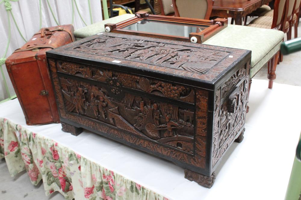 Vintage Chinese carved camphor trunk with ebonized trim